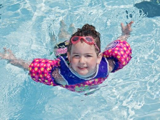 Girl swimming in outdoor pool