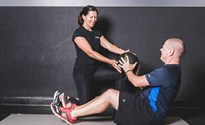Personal Trainer and Client Passing of a Medicne Ball