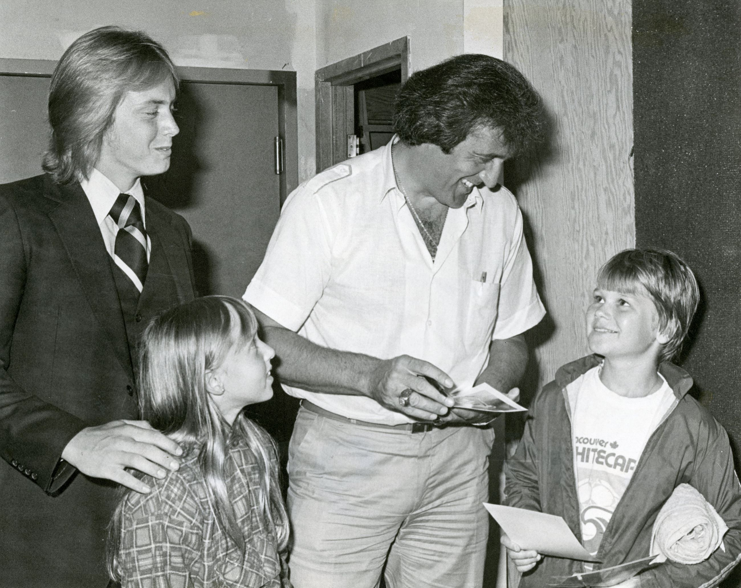Phil Esposito Signing Autographs at Coquitlam Centre, August 22, 1979 (JPG) Opens in new window