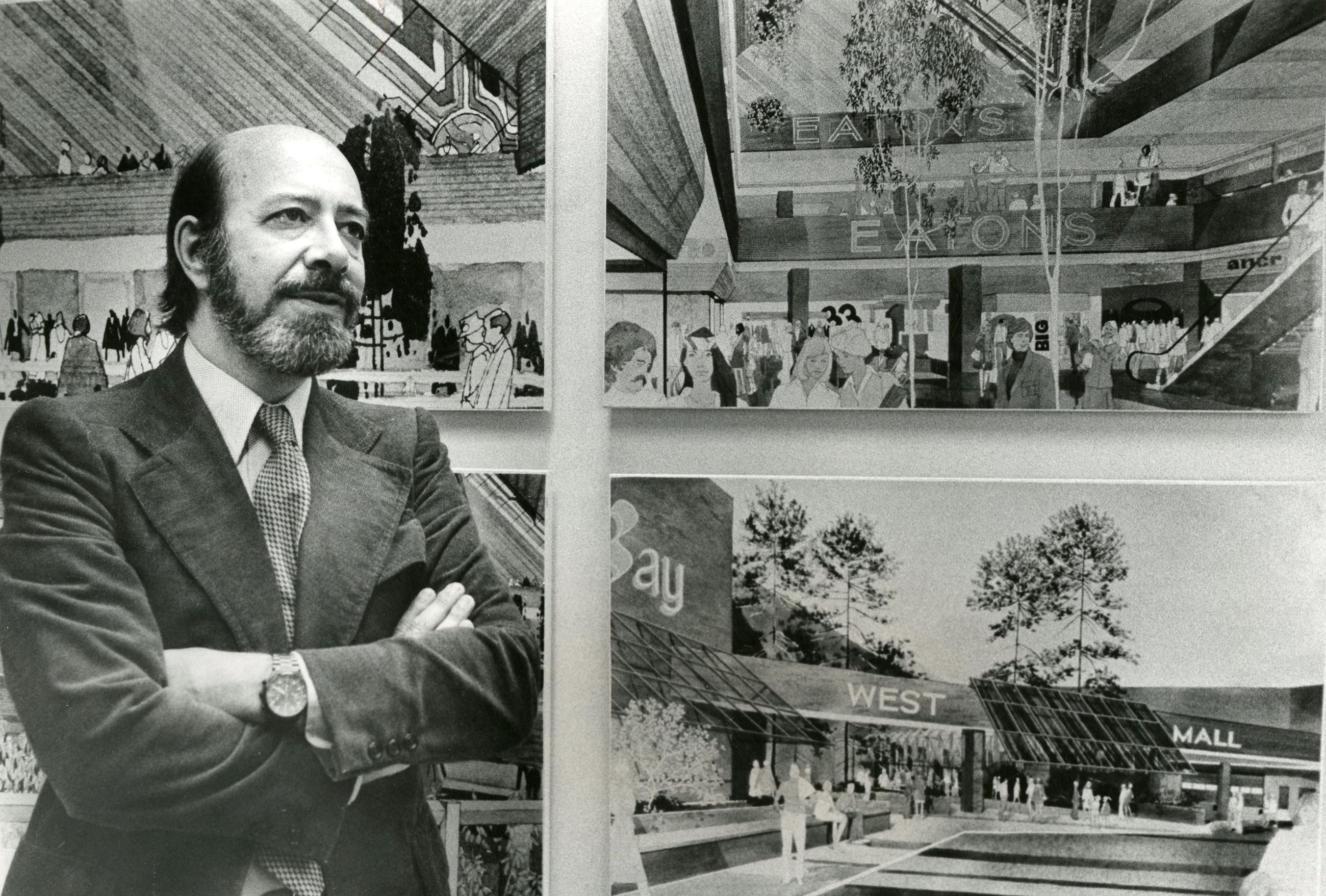 Ira Young in Front of Coquitlam Centre Drawings (JPG) Opens in new window
