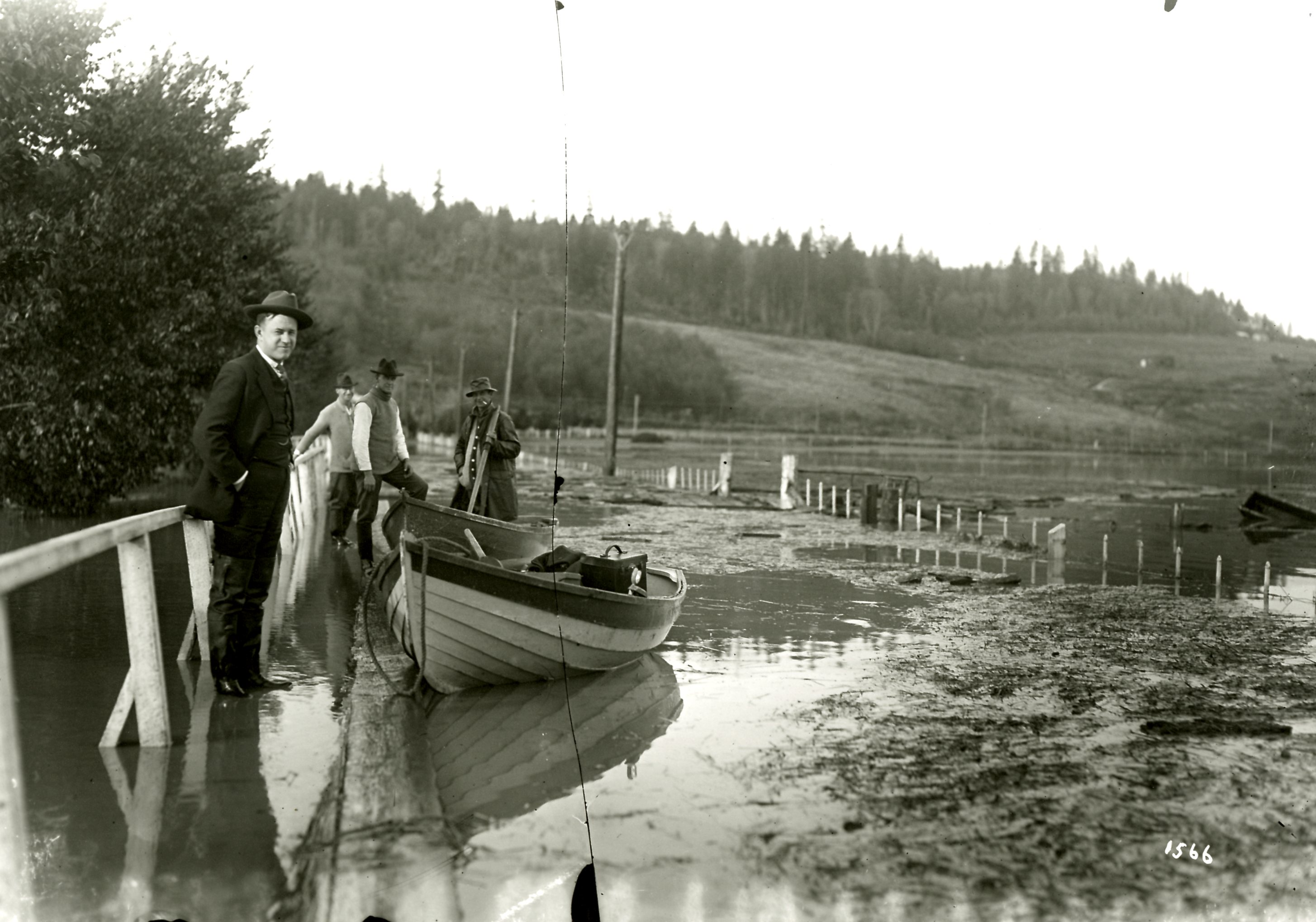 Broken Glass Plate Negative of a Man with a Boat During the Flood at Colony Farm, Circa 1921 (JPG) Opens in new window